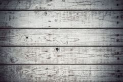 Texture of the painted shabby wooden flooring made of boards, grunge background. The texture of the painted shabby wooden flooring made of boards, close up royalty free stock photography