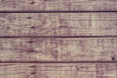 Texture of the painted shabby wooden flooring made of boards, grunge background. The texture of the painted shabby wooden flooring made of boards, close up stock image