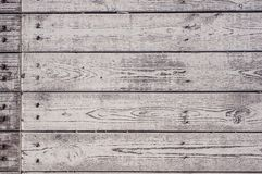 Texture of the painted shabby wooden flooring made of boards, grunge background. The texture of the painted shabby wooden flooring made of boards, close up royalty free stock photos