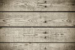 Texture of the painted shabby wooden flooring made of boards, grunge background. The texture of the painted shabby wooden flooring made of boards, close up stock photography