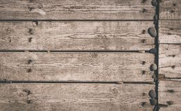 Texture of the painted shabby wooden flooring made of boards, grunge background. The texture of the painted shabby wooden flooring made of boards, close up royalty free stock photo