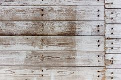 Texture of the painted shabby wooden flooring made of boards, grunge background. The texture of the painted shabby wooden flooring made of boards, close up stock photos