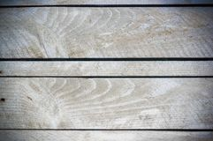 Texture of the painted shabby wooden flooring made of boards, grunge background. The texture of the painted shabby wooden flooring made of boards, close up stock photo