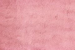 The texture of painting the wall in beautiful pink tones. Shot close up stock photo