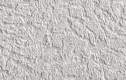 Texture - paper gray textured wallpaper. Texture - the surface of paper gray textured wallpaper Stock Photo