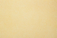Texture of paper with an unusual structure in small cell monochromatic warm beige shades for artwork. Modern background Royalty Free Stock Image