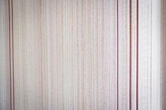Texture of paper wallpaper in a small strip of beige shades royalty free stock photo
