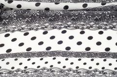 Texture, pattern, background. Cloth cotton. White fabric, painted with black polka dots, black lace. Black White Grunge Spots Fab. Ric - Grungy Polka stock images