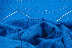 Texture pattern. Cloth blue dense with perforated holes. For the. Avant-garde or not very serious take in your design. Covered in different areas round holes stock photos