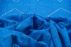 Texture pattern. Cloth blue dense with perforated holes. For the. Avant-garde or not very serious take in your design. Covered in different areas round holes stock photography