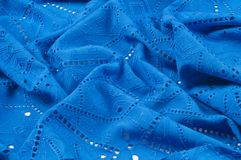 Texture pattern. Cloth blue dense with perforated holes. For the. Avant-garde or not very serious take in your design. Covered in different areas round holes stock image