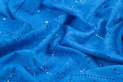 Texture pattern. Cloth blue dense with perforated holes. For the. Avant-garde or not very serious take in your design. Covered in different areas round holes royalty free stock images