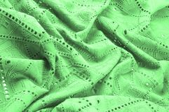 Texture, pattern. Cloth green dense with perforated holes. Perfo. Rated to perfection, which is twice as much fun Stock Photos