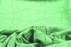 Texture, pattern. Cloth green dense with perforated holes. Perfo. Rated to perfection, which is twice as much fun Royalty Free Stock Images