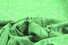 Texture, pattern. Cloth green dense with perforated holes. Perfo. Rated to perfection, which is twice as much fun Royalty Free Stock Photo