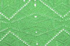 Texture, pattern. Cloth green dense with perforated holes. Perfo. Rated to perfection, which is twice as much fun Royalty Free Stock Photos