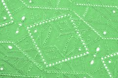 Texture, pattern. Cloth green dense with perforated holes. Perfo. Rated to perfection, which is twice as much fun Stock Photography