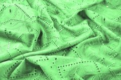 Texture, pattern. Cloth green dense with perforated holes. Perfo. Rated to perfection, which is twice as much fun Royalty Free Stock Image