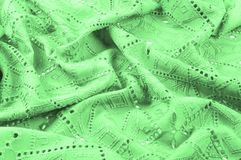 Texture, pattern. Cloth green dense with perforated holes. Perfo. Rated to perfection, which is twice as much fun Stock Images