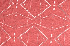 Texture, pattern. Cloth red dense with perforated holes. Stop yo. Ur search for perforated perfection with this army of red cloth! It contains fine drapery stock photo