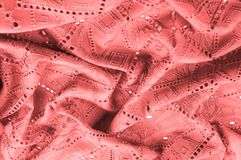 Texture, pattern. Cloth red dense with perforated holes. Stop yo. Ur search for perforated perfection with this army of red cloth! It contains fine drapery royalty free stock photo