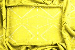 Texture, pattern. Cloth is yellow dense with perforated holes. P. Erforated with a delightful design, ripe for conversation. Providing an extremely soft surface stock photos