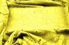 Texture, pattern. Cloth is yellow dense with perforated holes. P. Erforated with a delightful design, ripe for conversation. Providing an extremely soft surface stock photography
