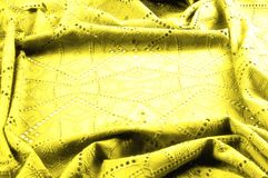 Texture, pattern. Cloth is yellow dense with perforated holes. P. Erforated with a delightful design, ripe for conversation. Providing an extremely soft surface royalty free stock photo