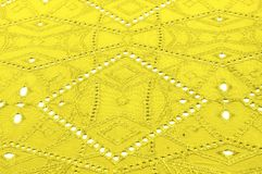 Texture, pattern. Cloth is yellow dense with perforated holes. P. Erforated with a delightful design, ripe for conversation. Providing an extremely soft surface royalty free stock photography