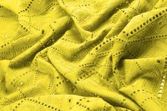 Texture, pattern. Cloth is yellow dense with perforated holes. P. Erforated with a delightful design, ripe for conversation. Providing an extremely soft surface stock images