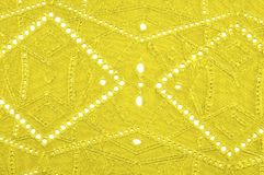Texture, pattern. Cloth is yellow dense with perforated holes. P. Erforated with a delightful design, ripe for conversation. Providing an extremely soft surface royalty free stock photos