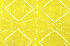 Texture, pattern. Cloth is yellow dense with perforated holes. P. Erforated with a delightful design, ripe for conversation. Providing an extremely soft surface royalty free stock image