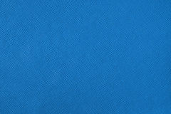Texture with a pattern of a plurality of lines. Colored blue background Stock Photos
