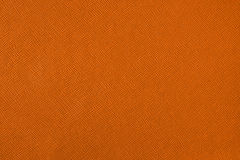 Texture with a pattern of a plurality of lines. Colored orange background Stock Photography