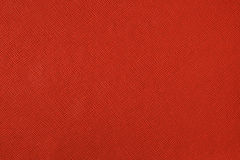 Texture with a pattern of a plurality of lines. Colored red background Royalty Free Stock Images