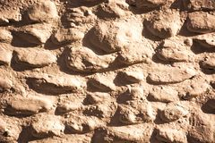 Stone wall pattern image,stone wall pattern picture,  masonry, stone wall pattern viewing, texture, wallpaper. Wall made of natural stones in the shape of Stock Image