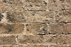 Stone wall pattern image,stone wall pattern picture,  masonry, stone wall pattern viewing, texture, wallpaper. Wall made of natural stones squared and well put Stock Photography