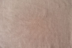 Texture of peach colored polyester fabric Royalty Free Stock Image