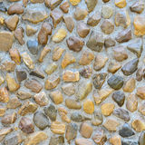 Texture of pebble stones wall. For background Stock Images