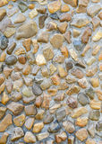 Texture of pebble stones wall. For background Royalty Free Stock Images