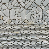 Texture of pebble stones wall. For background Stock Photos