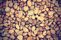 Texture of pebbles or of gravel stone from water fall Stock Images