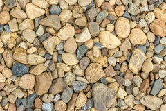 Texture of pebbles. Small beautiful colorful pebbles, Multicolored little rocky background royalty free stock images