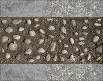 Texture pebbles and stone. Paving in pebbles and reggina stone a tipical stone of reggio calabria italy Stock Photos