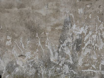 Texture of peeled plaster at old house. Old wall with crags. Stock Photo