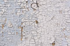 Texture of peeling white paint on a wooden wall. Surface with worn material royalty free stock photos