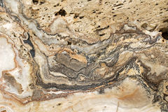 Texture photo of Onyx marble, silver banded rock in brown gray w Stock Images