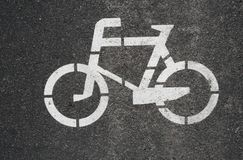 Texture. A picture of a bicycle on the asphalt. stock images
