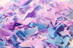 Texture, pieces of cut fabric in two colors blue and pink. Pieces of finely chopped cloth coarse calico in a shuffle of two colors: pink and blue, texture Stock Images