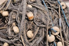 Texture of pile of fishing nets with floats stock photography